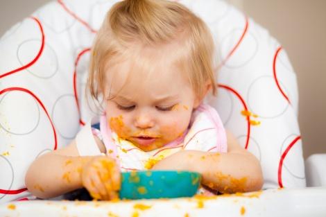 Little girl having a messy lunch